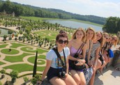 Tourists Enjoying Versailles' Garden
