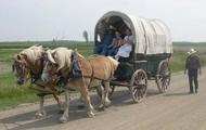 man walking by a wagon