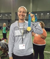 Abby Goodlaxon shows off a gold medal