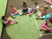 The girls are haveing a serious round table, er... carpet discussion.
