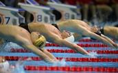 Nck Thoman, left, Ryan Lochte and Kip Darody start in the 100 meters backstroke for men
