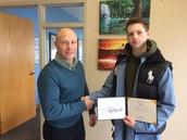 Max Accepting his Diploma