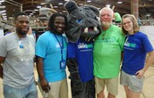 Texarkana College Recruiters, mascot Beau, and Executive Director, Sam Clem, at the race.