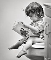 Child reads on the potty