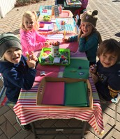 Lucas, Arlo, Sydney, and Mila making cards together