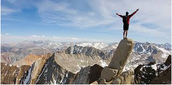 A person  who has just perserverd by climbing a mountian