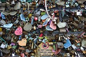 PUT A LOCK ON THE LOCK BRIDGE IN PARIS