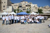 Students from  a Talmudic college embrace them with love, singing and dancing