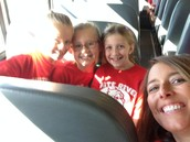 Jordyn,Elyse, Kate,and Mrs.Bachman on the bus!