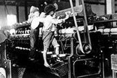 Kids working on a machine