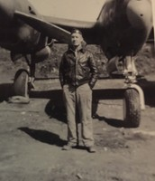 Samuel in front of a P-38 Lightning