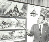 Walt showing plans for Disneyland