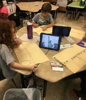 Ms. Simons's 2nd grade Panthers research American symbols on iPads & make flip books.