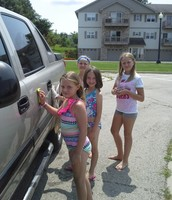 Campers loved washing cars and raised over $100 for Norski Nibbles!