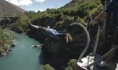1) Bungee jumping in New Zealand with my brother