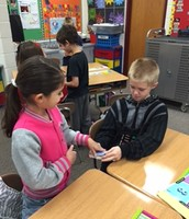 Students practicing the card trick