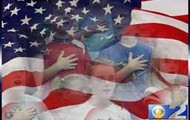 Students saluting the United States flag
