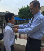 Diego and Mr. Pattullo get ready for mass!