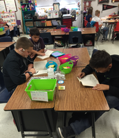 Students listening to audio book on iPad