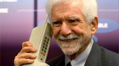 Martin Cooper with the first cell phone ever invented