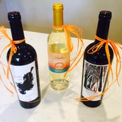 Three beautiful bottles of wine to be raffled off!