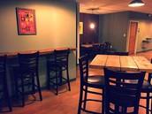 Bar top tables and bar stools
