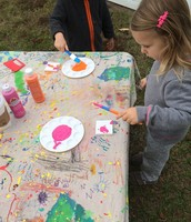 Madison chooses to start her splatter paint with bright pink