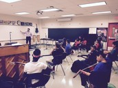 Mr. Burlin's class learning guitar the first week of school