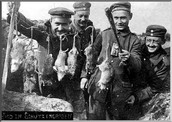 Soldiers show off their catch after a Rat Hunt