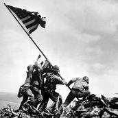 Soldiers raising U.S. flag