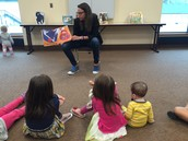 Srta. Amy reads at the final Spanish Reading Night at PL Library