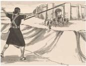יהושע מטה את כידונו לעבר העיר עי