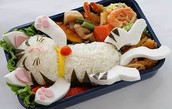 kitty made out of sea food an rice.