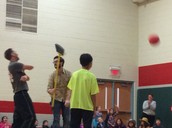 Mr. Johnson used a broom to block Mr. Boyton's shots.
