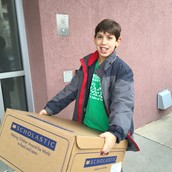 Stanley carrying in some donations.