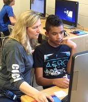 Ms. Redmond helping a student