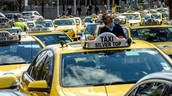 Uber passengers to begin paying AU$100m taxi compensation