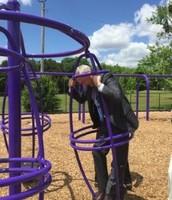 Superintendent Wardynski enjoying  Dawson's Playground Equipment