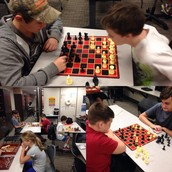 JH Students enjoying a game of chess as a reward