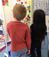 Chris and Isabella making words.