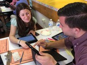 Teachers communicating using iPads