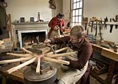 Wheelwrights tend to their craft in the Deane Shop.