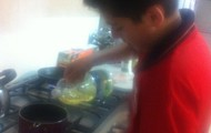 Pouring vegetable oil on the pans