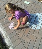 Olivia sketching hearts