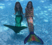 Sarah and Samantha Buckley (Mrs. Buckley's daughters) enjoyed their backyard pool in their mermaid suits