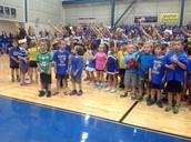 Kinder and Cheerleaders singing the school song