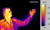 his hand is in a bag but with thermal imaging you can see through it