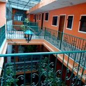 Hotel Plaza It is a building of the early twentieth century with a family atmosphere .  It has 22 comfortable rooms with T.V. Wired and parking  Stay with us , we guarantee you a comforting stay and friendly service .