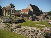 The spread of Christianity in Britain began with Augustine establishing a monastery at which location?