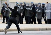 A protester throwing a brick at the police